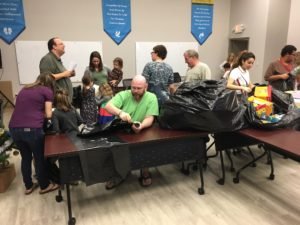 LSF sorting donated gifts for refugee program